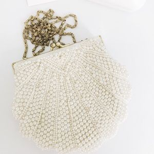 Pearl beaded shell clutch